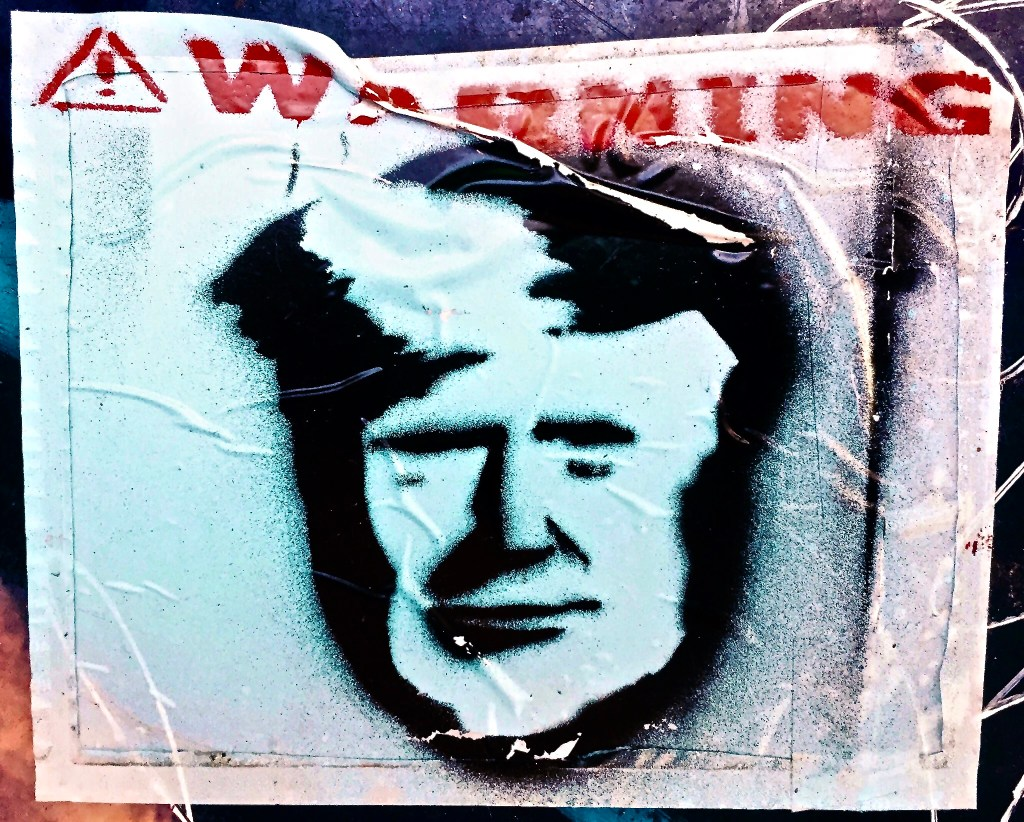 """Sticker with tRump's visage and """"Warning"""""""