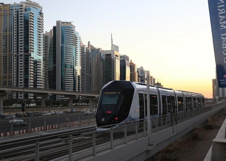 Dubai's new tram moves out of a station at the Marina in Dubai on November 12, 2014. AFP/Marwan Naamani