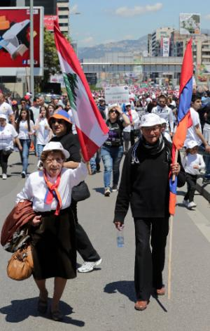 Lebanese Armenians march with flags and signs on the…