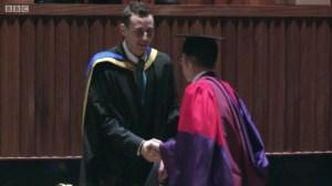 Sam receiving his degree
