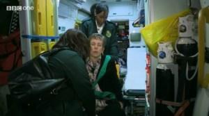 Christine is transferred onto the ambulance