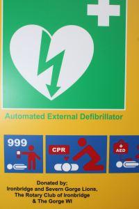 Defibrillator outside Ironbridge public toilets - box close-up
