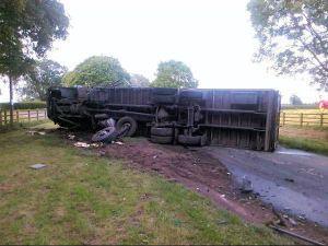 A serious crash left a man trapped in a car for 50 minutes and a lorry on its side