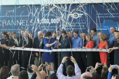 City officials and JetBlue executives cut the ribbon on the airline's new hotel for employees. Photo: Matthew Peddie, WMFE