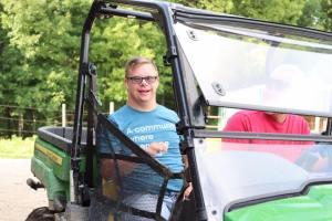 Young man riding in a 4-wheeler smiling