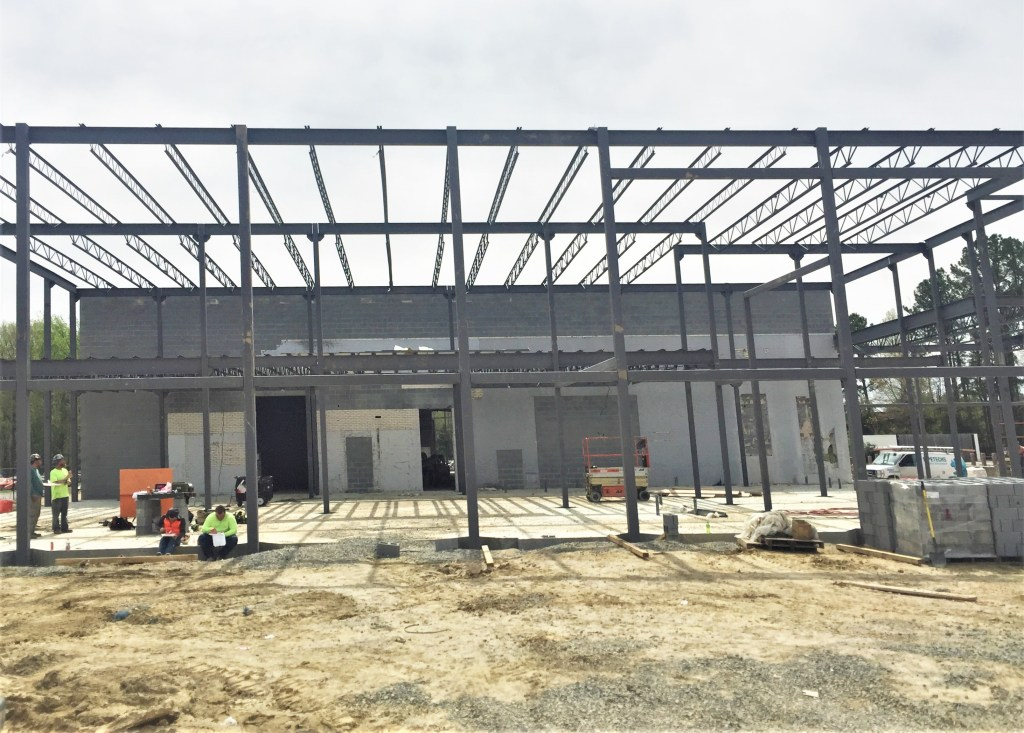 Structural steel building with joist