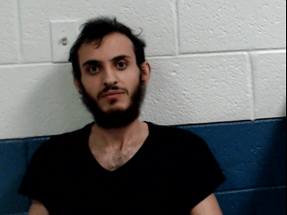 arrested for stabbing a woman