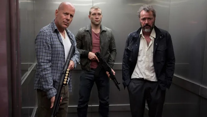 Bruce Willis and Jai Courtney as John and Jack McClane in A Good Day to Die Hard