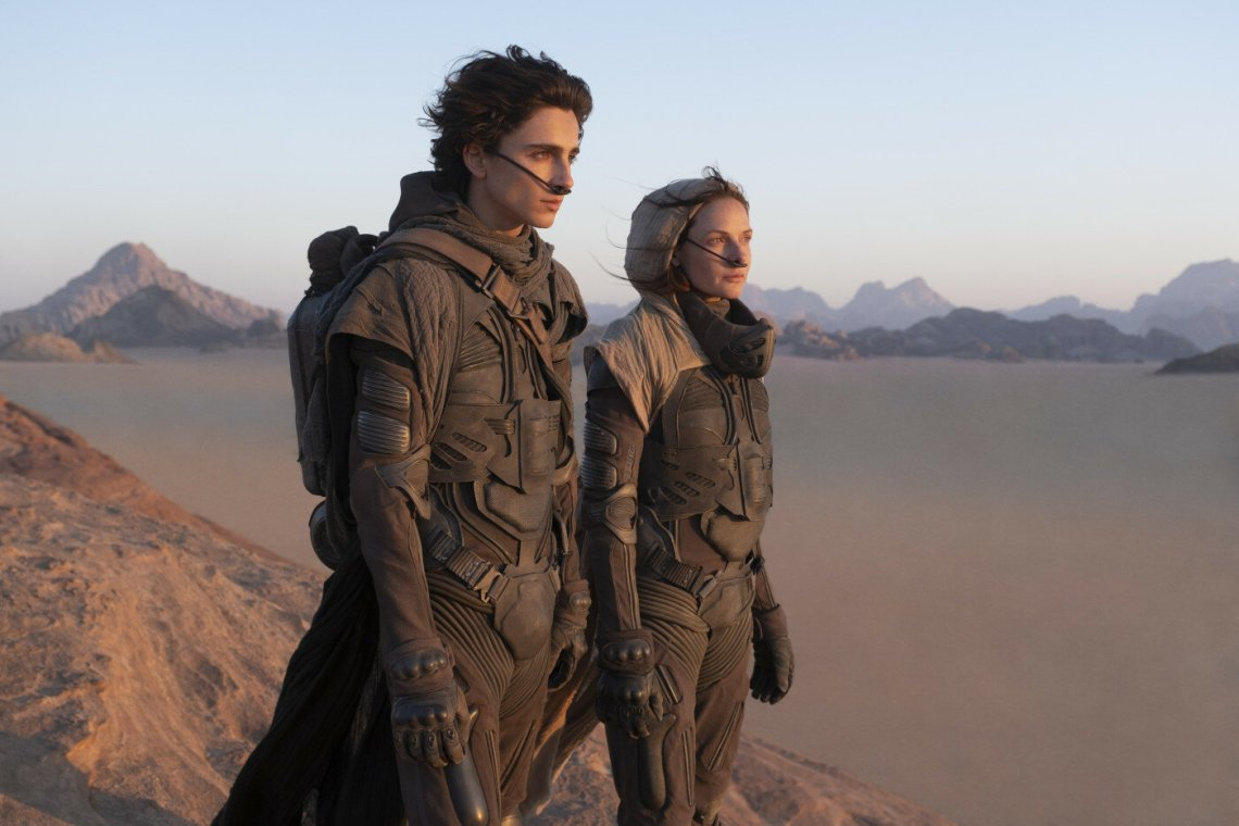 Dune: Part One : Lady Jessica and Paul stand on a hill in the desert