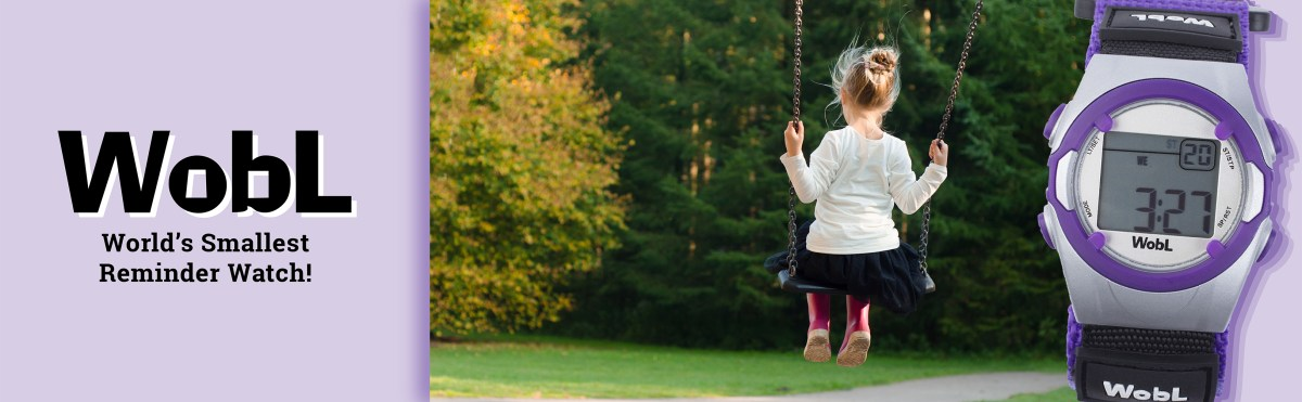 "WobL watch in purple with photo of young girl on a swing; text ""WobL Watch, World's Smallest Reminder Watch"""