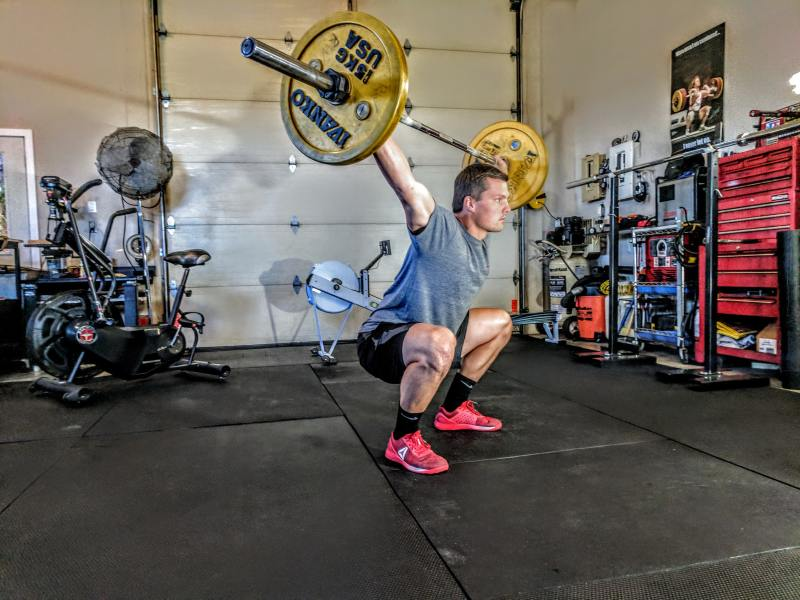 The overhead squat can be a tough movement until you build up your overhead balance and strength.