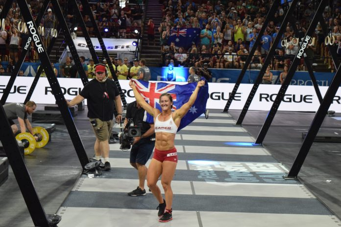Tia-Clair Toomey of Australia celebrates on the floor of the Coliseum after winning her third-consecutive CrossFit Games