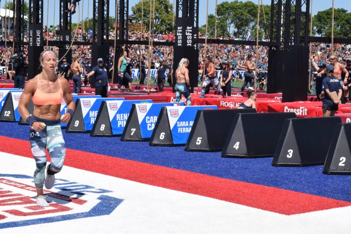 Amanda Barnhart heads out for a run before another round of legless rope climbs at the 2019 CrossFit Games