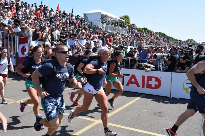 Scott Panchik and other athletes complete the Ruck Run event at the 2019 CrossFit Games