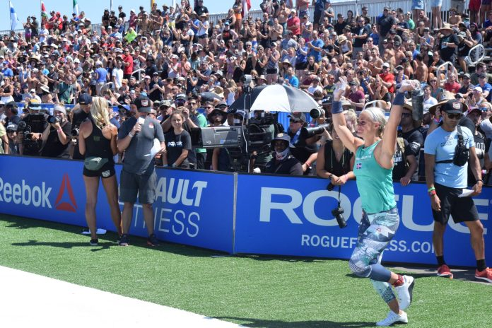 Sara Sigmundsdottir waves at the crowd as she enters the stadium for the first event of the 2019 CrossFit Games