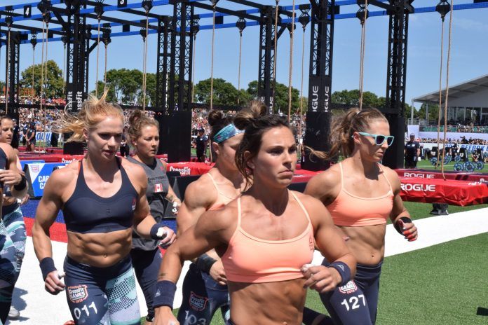 Karin Freyova and the pack take their first lap before completing legless rope climbs at the 2019 CrossFit Games