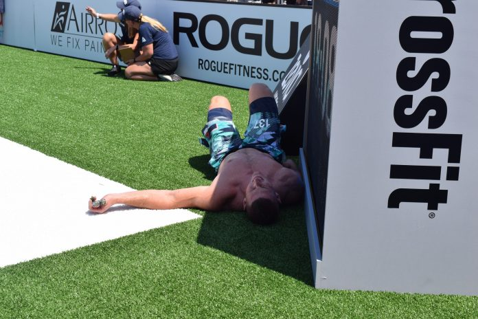 Jason Smith seeks shade after an event at the 2019 CrossFit Games
