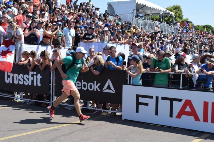 Brent Fikowski of Canada completes the Ruck Run event at the 2019 CrossFit Games