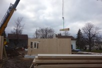 The first of two drop beams is lifted into place