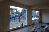Looking south through what will be the French windows, towards the barn and the crane.