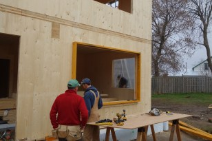Chris and Steve preparing the openings for window installation