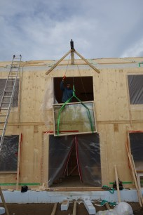 Chris had to make a special hoist to lift the large and heavy windows into the second floor