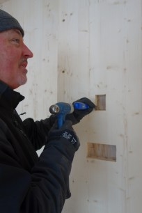 Steve chiselling out the corners of the electrical receptical holes