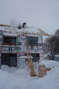 Clearing snow off the roof (1)