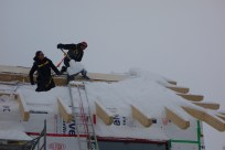 Clearing snow off the roof (2)