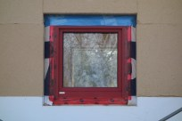 Pantry window surrounded by insulation