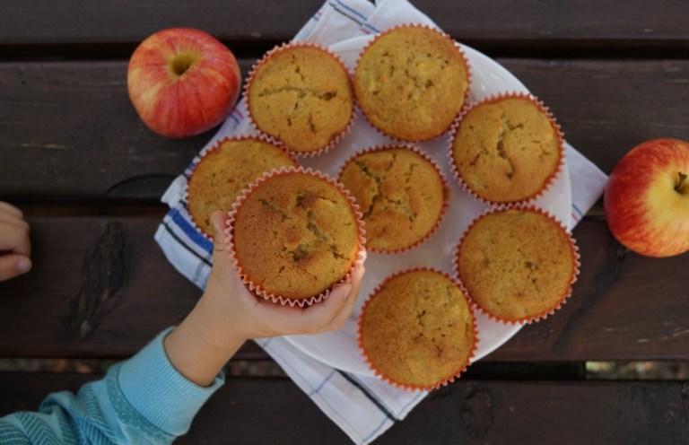 Kid holding Pumpkin Apple Muffin