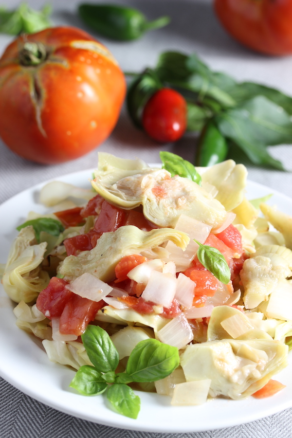 Vegan Creamy Artichoke and Tomato Sauce over cabbage