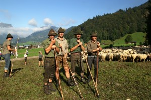 Shepherds in Bavarian dresses and a woman shepherd in the background