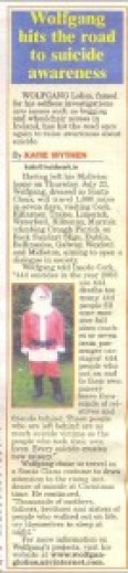 Newspaper clip with Wolfgang Lolies as Santa