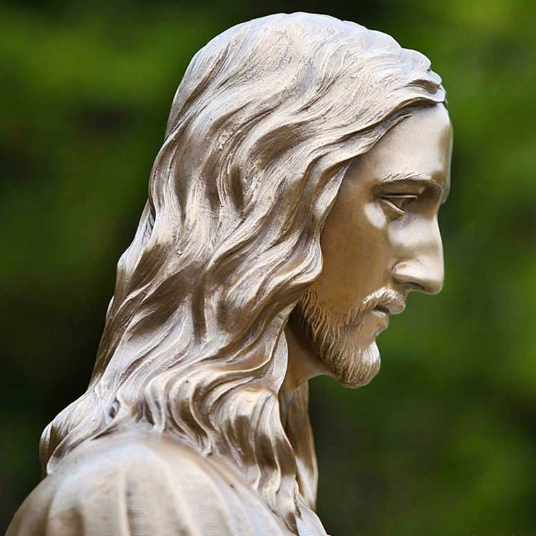 Close up of the bronze Jesus statue's face