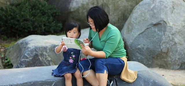 A mother teaches a child about the rocks in Wolmyeongdong