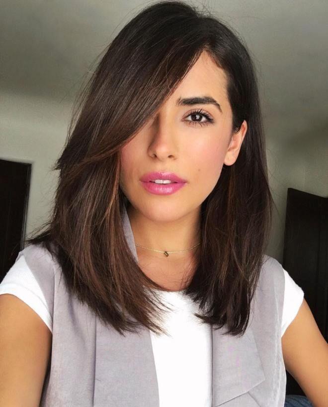 slanting bangs on medium brunette hair