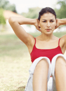 WOMAN in red tank top doing sit ups as part of an exercise - provided by Microsoft