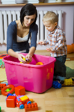 Woman and toddler with toys - By Fotolia