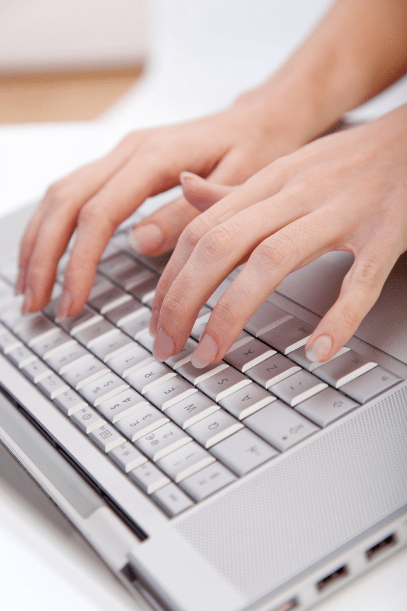 woman typing for the WCHAT Blog page