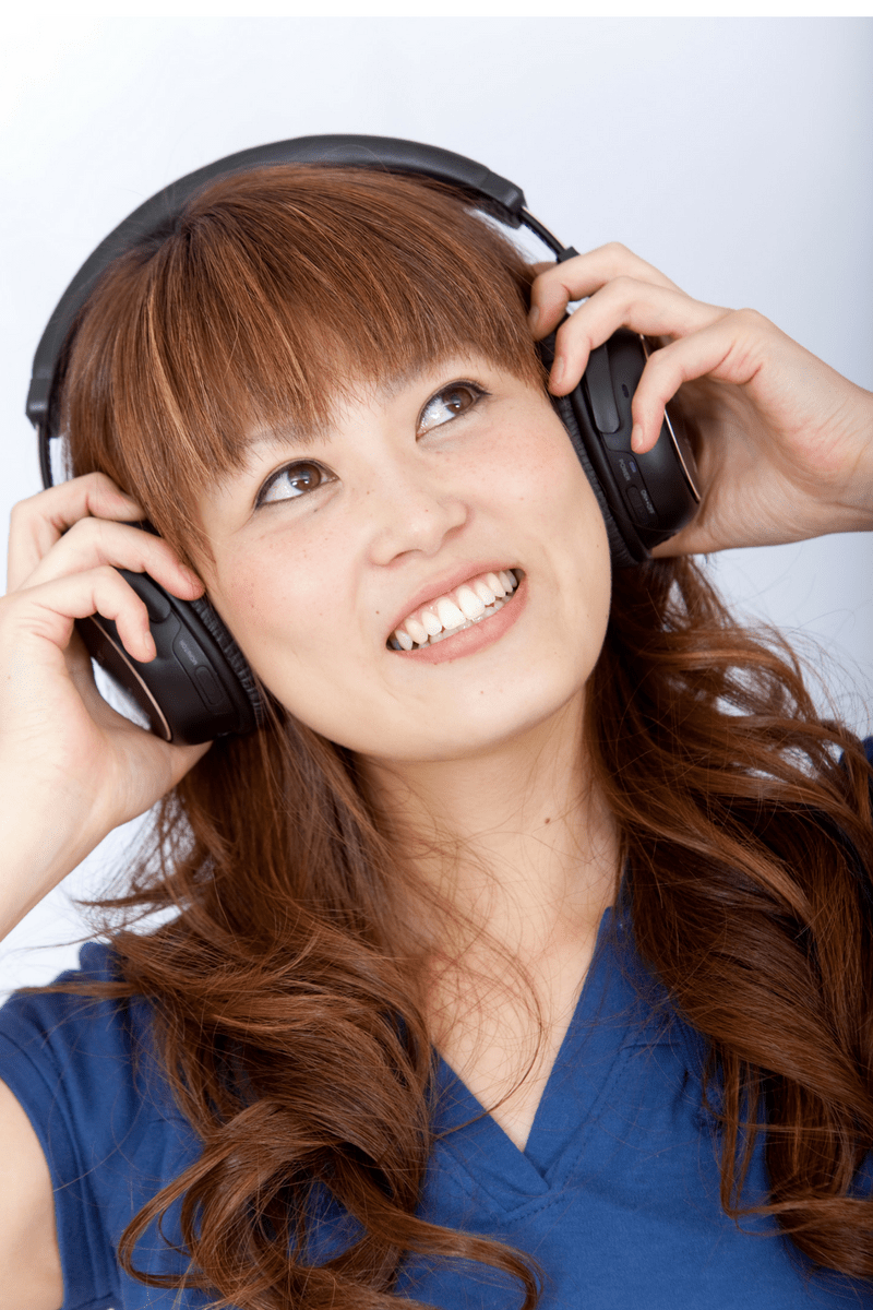 Woman listening to a podcast and wearing headphones