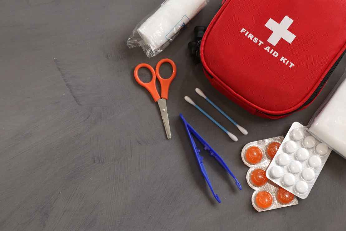 first aid kit on gray background