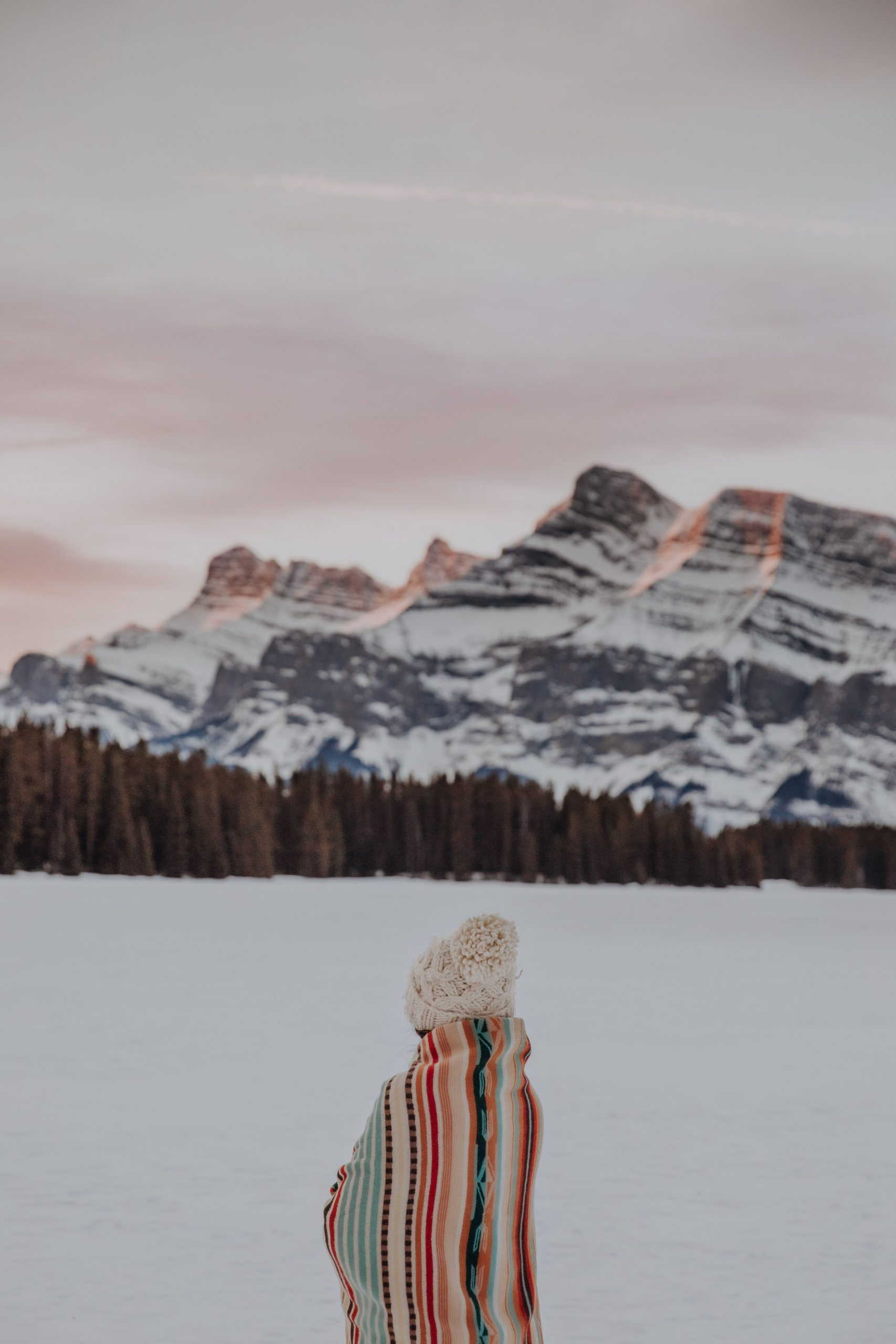 Girl at Two Jack Lake for a winter sunrise
