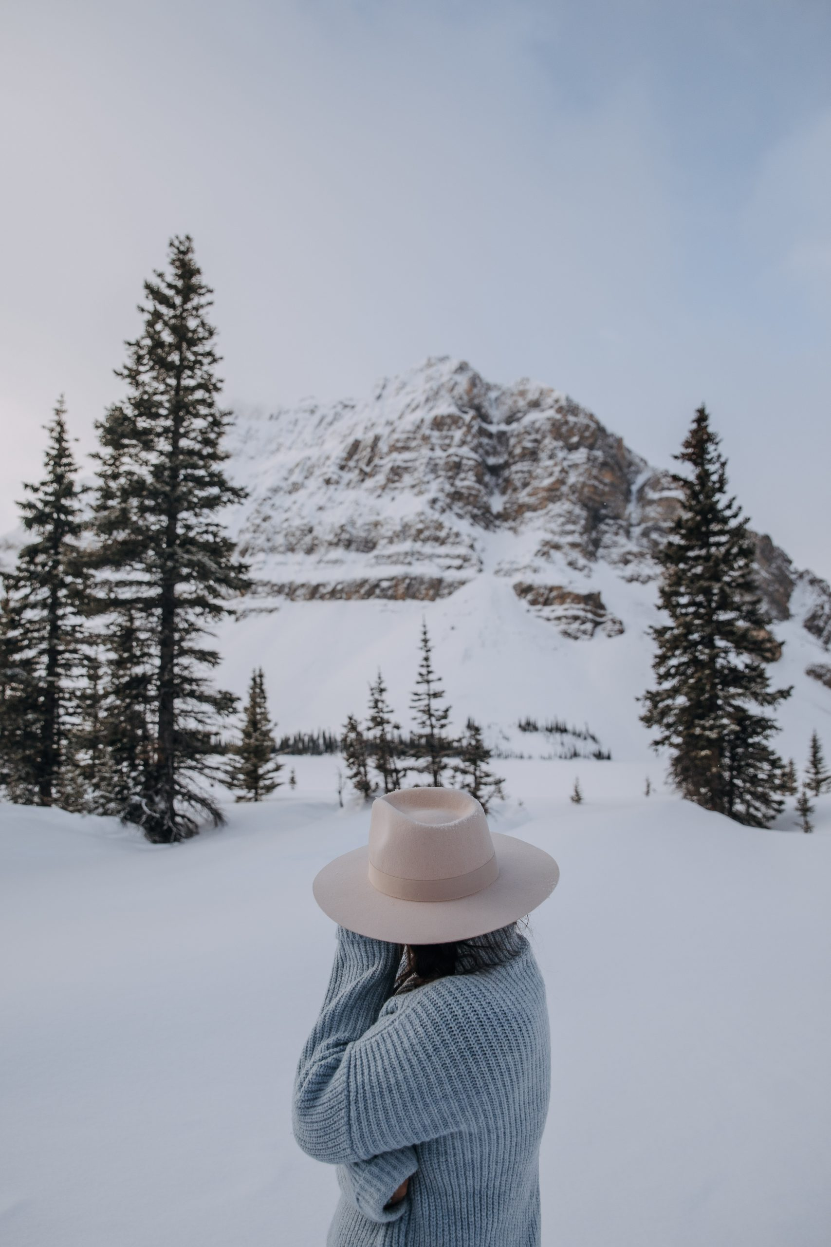 The Ultimate Banff Winter Guide - Girl at Bow Lake in the Winter