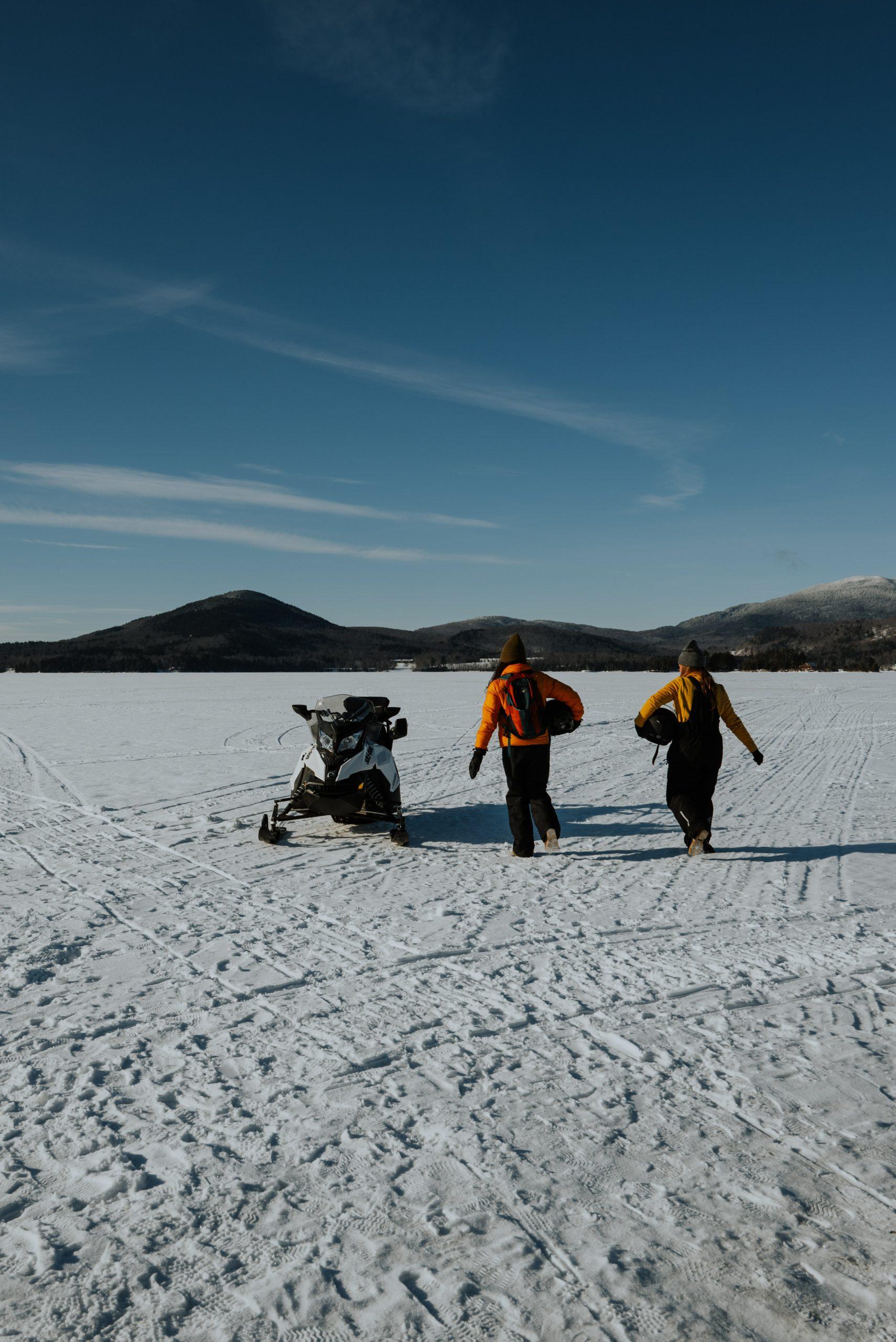 Girls Snowmobiling on Moosehead Lake in Maine