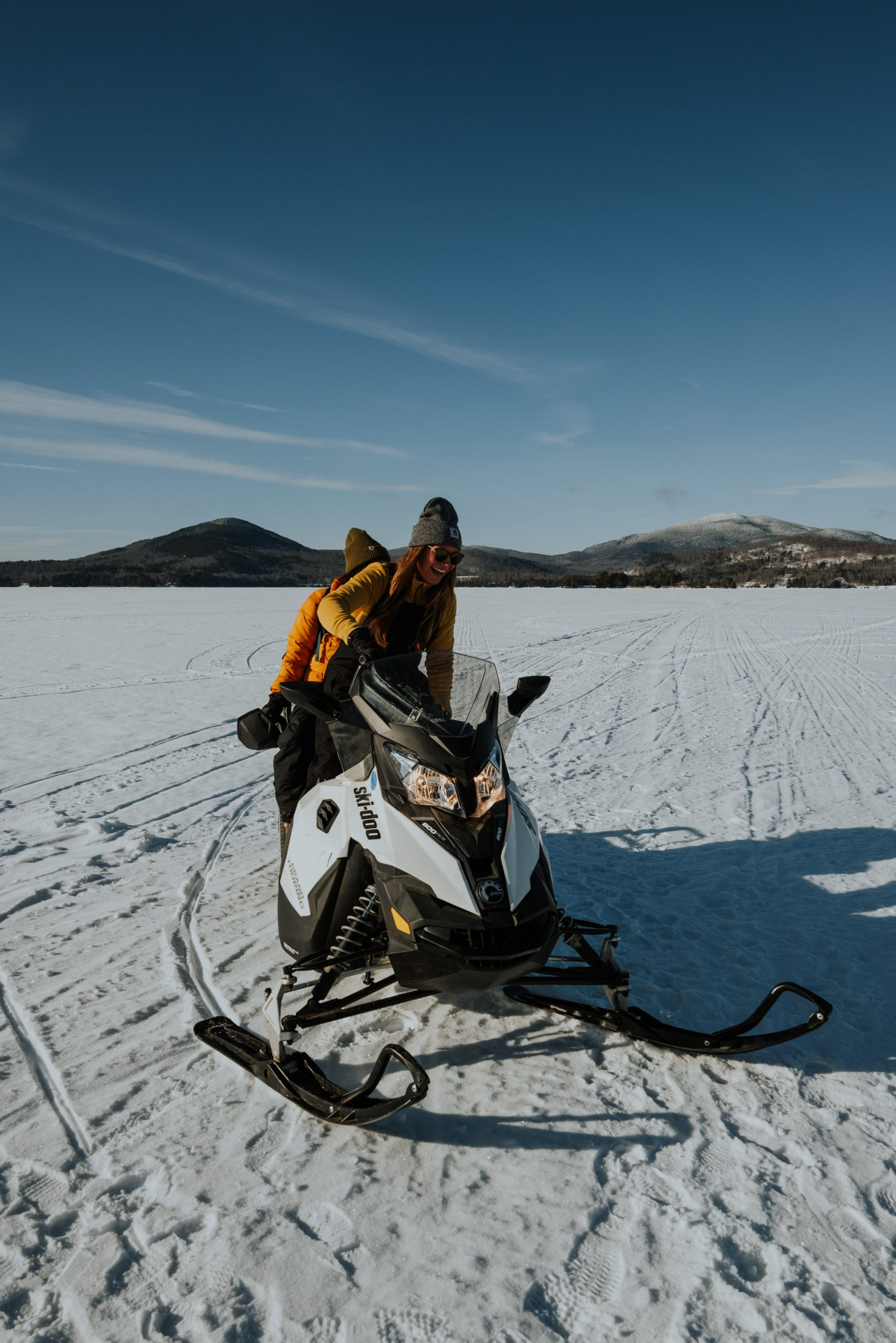 Girls Snowmobiling on Moosehead Lake in Maine