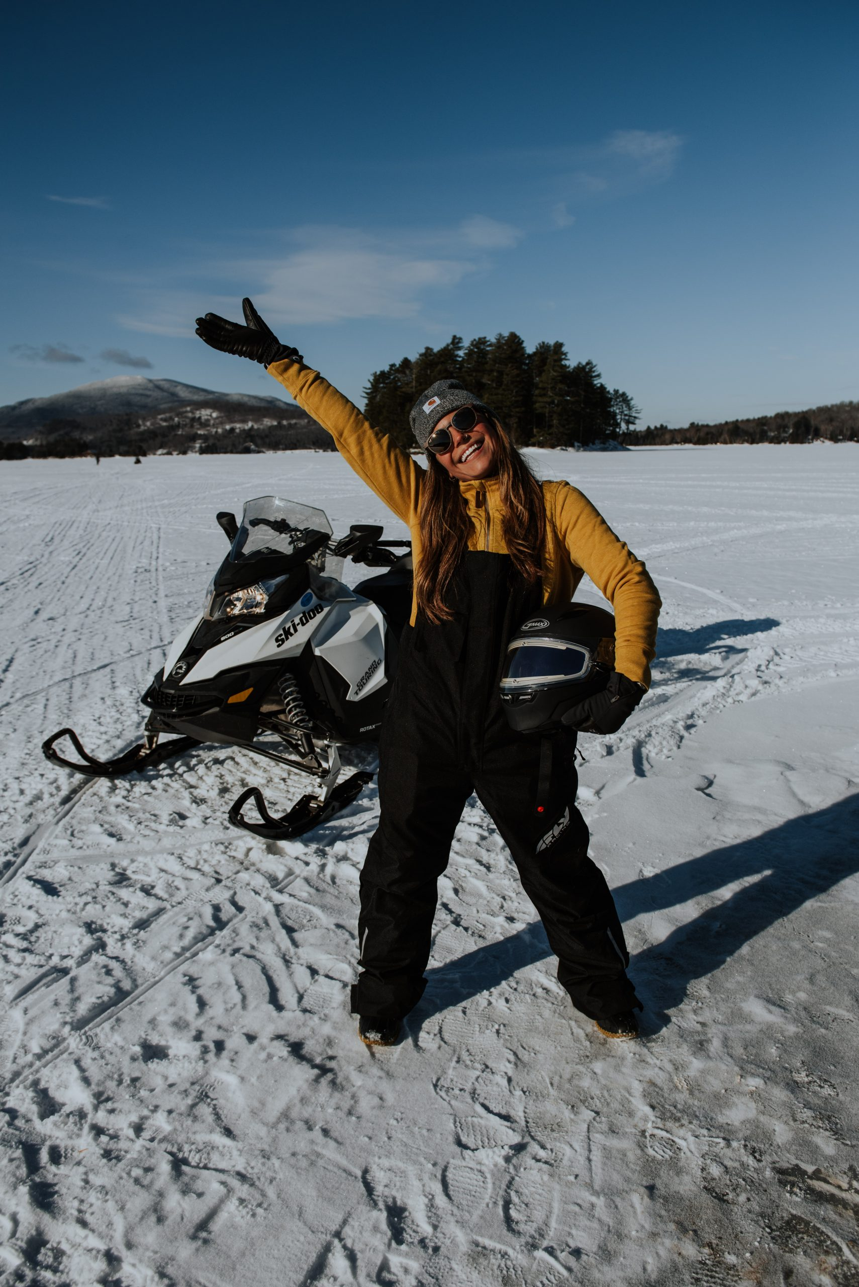 Girl snowmobiling on Moosehead Lake in Maine