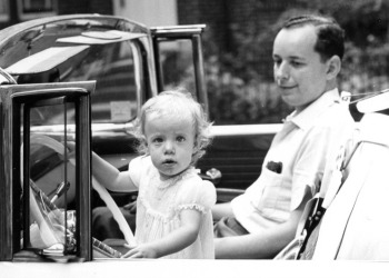 father & daughter in car black & white photo