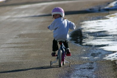 child riding cycle