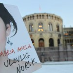 Maria Amelie poster in front of Norway's parliament building